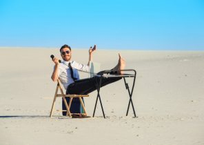 businessman-using-laptop-desert_155003-10621